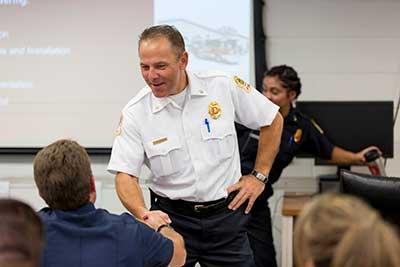 firefighter shaking hands